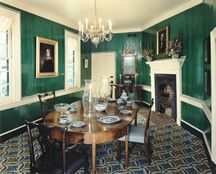 The dining room is painted in a bright verdigris green popular in the late eighteenth century.