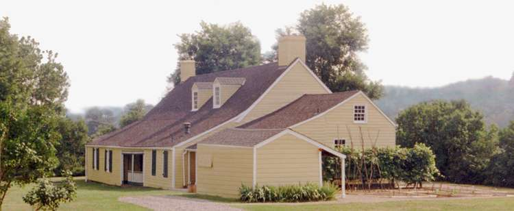 Rear view of the house with the grape arbor on the right.