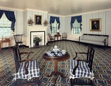 The parlor, with replica wallpaper in the original pattern.
